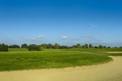 General view of a green golf course on a bright sunny day. Idyllic summer landscape. Sport, relax, recreation and Royalty Free Stock Photography