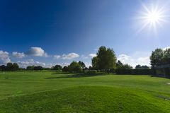 General view of a green golf course on a bright sunny day. Idyllic summer landscape. Sport, relax, recreation and Stock Images