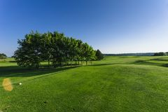 General view of a green golf course on a bright sunny day. Idyllic summer landscape. Sport, relax, recreation and Stock Image