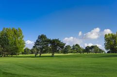 General view of a green golf course on a bright sunny day. Idyllic summer landscape. Sport, relax, recreation and Stock Photo