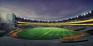 General view of illuminated baseball stadium and grass playground from the grandstand royalty free stock images