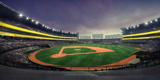 General view of illuminated baseball stadium and playground from the grandstand stock images