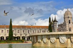 LISBON, PORTUGAL - NOVEMBER 3, 2017: General view of Jeronimos Monastery from Praca do Imperio Square with seagulls and a fountain stock photo