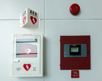 Portable automated external defibrillator AED and fire alarm system royalty free stock image