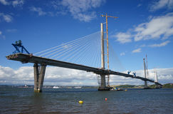A general view of the new Queensferry Crossing Bridge under construction, seen from Port Edgar Edinburgh, Scotland. Showing one of the tower cranes royalty free stock images