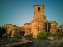 General view of Saint Mary`s church clocktower. General view of Saint Mary`s church and monastery of the village of Estany in northeastern Catalonia. It stock photography