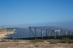 General view from the side of an electric power plant with solar panels. Electric power plant of solar panels where the renewable energy of sunlight is used as Stock Photo