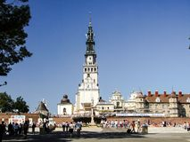 General view on square at Jasna Gora Monastery in Czestochowa in Poland. Pilgrims visiting the Jasna Gora. Many people seen from behind or walking. Photo taken Stock Images