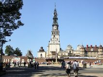 General view on square at Jasna Gora Monastery in Czestochowa in Poland. Pilgrims visiting the Jasna Gora. Many people seen from behind or walking. Couple in the Stock Photos