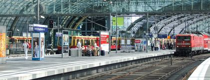 General view on traffic in Berlin Central terminal. Class 143 DB electric locomotive in push-pull set configuration and electric multiple unit of s-bahn in upper Stock Photography