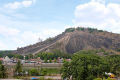 General view of Vindhyagiri hill temple complex, Sravanabelgola, Karnataka. View from Chandragiri hill. Large Belgola, white pond, royalty free stock image