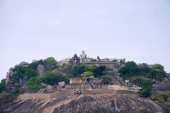 General view of Vindhyagiri hill temple complex, Sravanabelgola, Karnataka. View from Chandragiri hill. Large Belgola, white pond, royalty free stock images