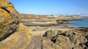 General view of the walled city of Saint Malo from Grand Be Island at low tide with colorful rocks in the foreground, Saint Malo stock photo