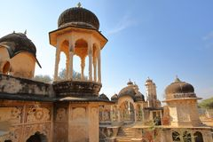 DUNDLOD, RAJASTHAN, INDIA - DECEMBER 27, 2017: General view of a well with turrets and cenotaphs and mural paintings in the foregr. General view of a well with Stock Photos