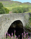 General Wade's bridge over the Riiver Almond built in 1730. Single span military bridge carrying the Crieff to Dalnacardoch road over the River Almond in the Sma Royalty Free Stock Image