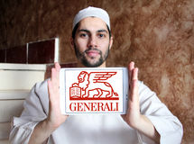 Generali insurance logo. Logo of generali insurance company on samsung tablet holded by arab muslim man Royalty Free Stock Photography