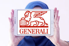 Generali insurance logo. Logo of generali insurance company on samsung tablet holded by arab muslim woman Royalty Free Stock Photos