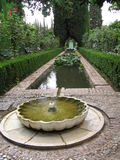 Generalife - Alhambra. A fountain in Generalife gardens, a palace in Alhambra, Granada, Spain Royalty Free Stock Image