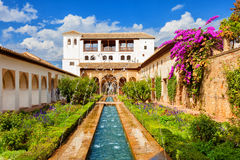 The Generalife of the Alhambra de Granada, Spain. General view of the Generalife with its famous fountain and garden. UNESCO World Heritage Site Royalty Free Stock Images