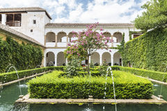 Generalife gardens at the Alhambra in Granada, Spain. Granada, Spain - August 11, 2015: Generalife gardens inside the fortress of the Alhambra in Granada Royalty Free Stock Photography
