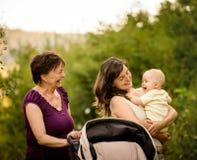 Generaties - grootmoeder, moeder, baby stock fotografie