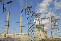 Generating Power. Fossil fuel pwoer generating plant and transmission lines Stock Images