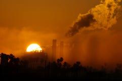 Generating station. California wild fire smoke brings orange glow to sunrise over a generating station Stock Image
