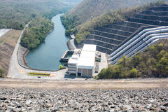 Generating station with a stream of water from the dam. Stock Image