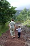 Generation. Woman, grandmother, and young child walking together Royalty Free Stock Image