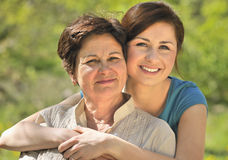 Generation. A happy senior woman with her granddaughter outdoors Stock Photography