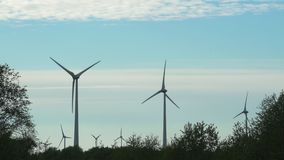 Generation of clean renewable electricity energy. Static. Wind turbines in fields. Generation of clean renewable electricity energy. Static shot stock footage