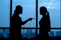 Generation conflict. Silhouette of women punishing her teenage daughter: generation conflict stock photo