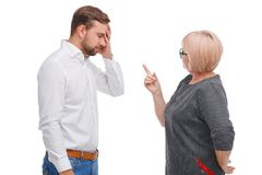 Generation conflict. Young man and older woman. Generation conflict. Young men and older women disagreement royalty free stock photography
