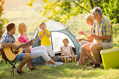 Generation family playing a guitar Royalty Free Stock Photos