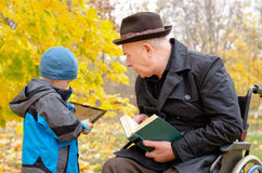 Generation gap between grandchild and grandfather Royalty Free Stock Photo