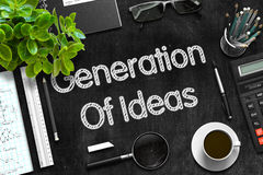 Generation Of Ideas on Black Chalkboard. 3D Rendering. Black Chalkboard with Handwritten Business Concept - Generation Of Ideas - on Black Office Desk and Other Royalty Free Stock Images