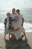 Generation of Men. A family portrait of three generations in one family. Father, Son and grandsons. Standing on the shore of the ocean royalty free stock image