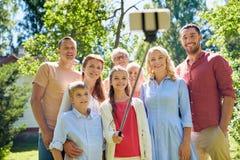 Happy family taking selfie in summer garden stock images