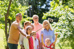Happy family taking selfie in summer garden Stock Photography