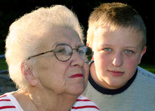 Generation Portrait 6. Portrait of grandmother in profile, and teenage grandson in full face royalty free stock images