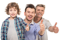 Generation. Portrait. Grandfather, father and son showing thumbs up isolated a white background stock images