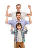 Generation. Portrait. Power. Grandfather, father and son isolated a white background royalty free stock photos