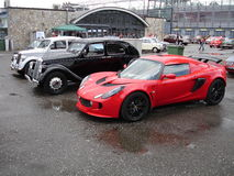 Generations. A new Lotus Exige parked at the side of wo classic cars at Monza for the 2008 Coppa Intereuropa Stock Photo