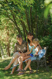 3 generations on bench Royalty Free Stock Images