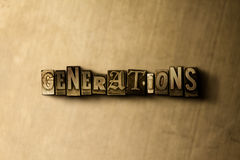 GENERATIONS - close-up of grungy vintage typeset word on metal backdrop Stock Photography