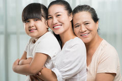 Generations. Close-up portrait of female generations of a family posing at camera Royalty Free Stock Image