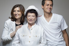 3 generations family in white cloths. Stock Photography