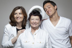 3 generations family in white cloths. Royalty Free Stock Photo