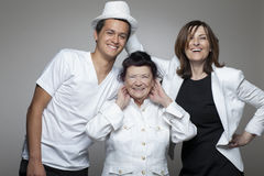 3 generations family in white cloths. Stock Images