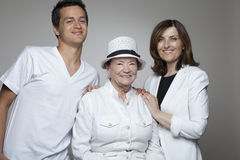 3 generations family in white cloths. Royalty Free Stock Image